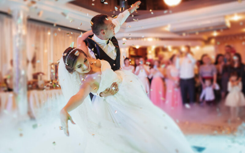 Happy,Bride,And,Groom,And,Their,First,Dance,,Wedding,In